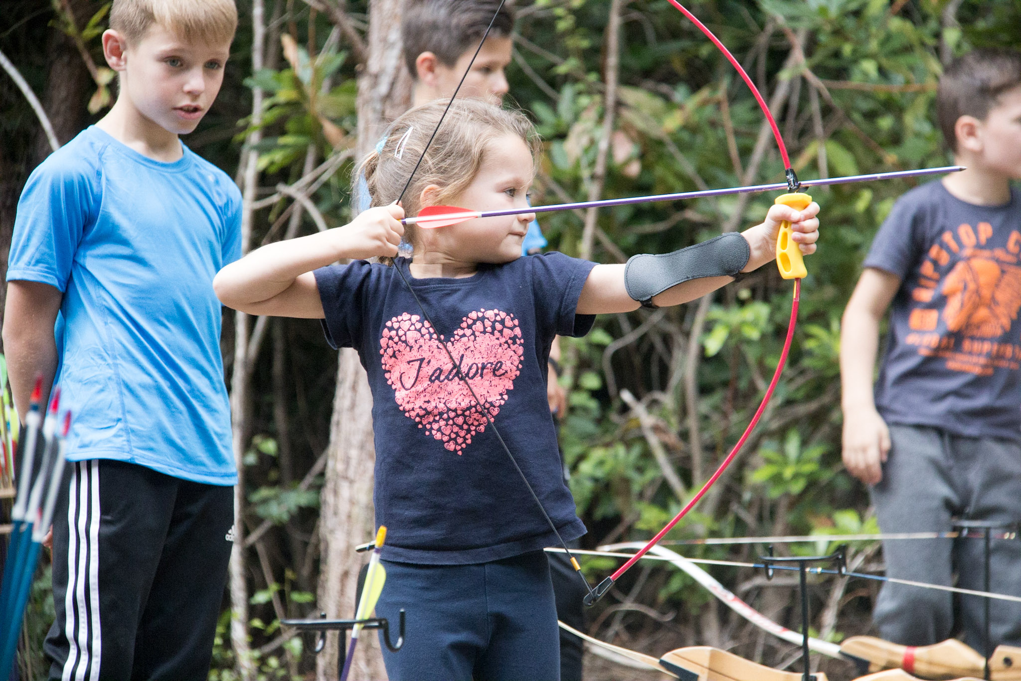 A daughter taking part in a Family Archery session.
