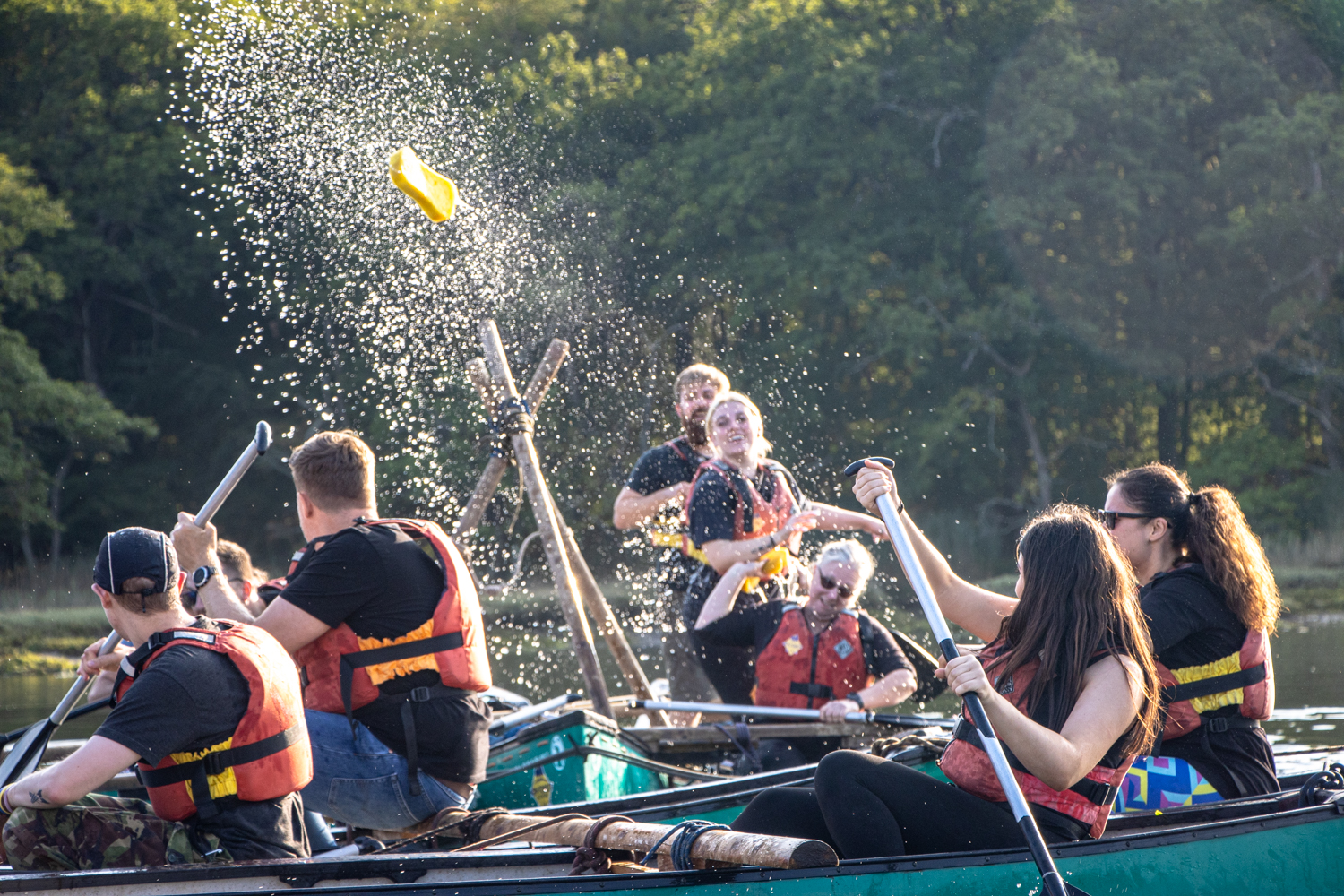 A group taking part in raft building on the Beaulieu River.