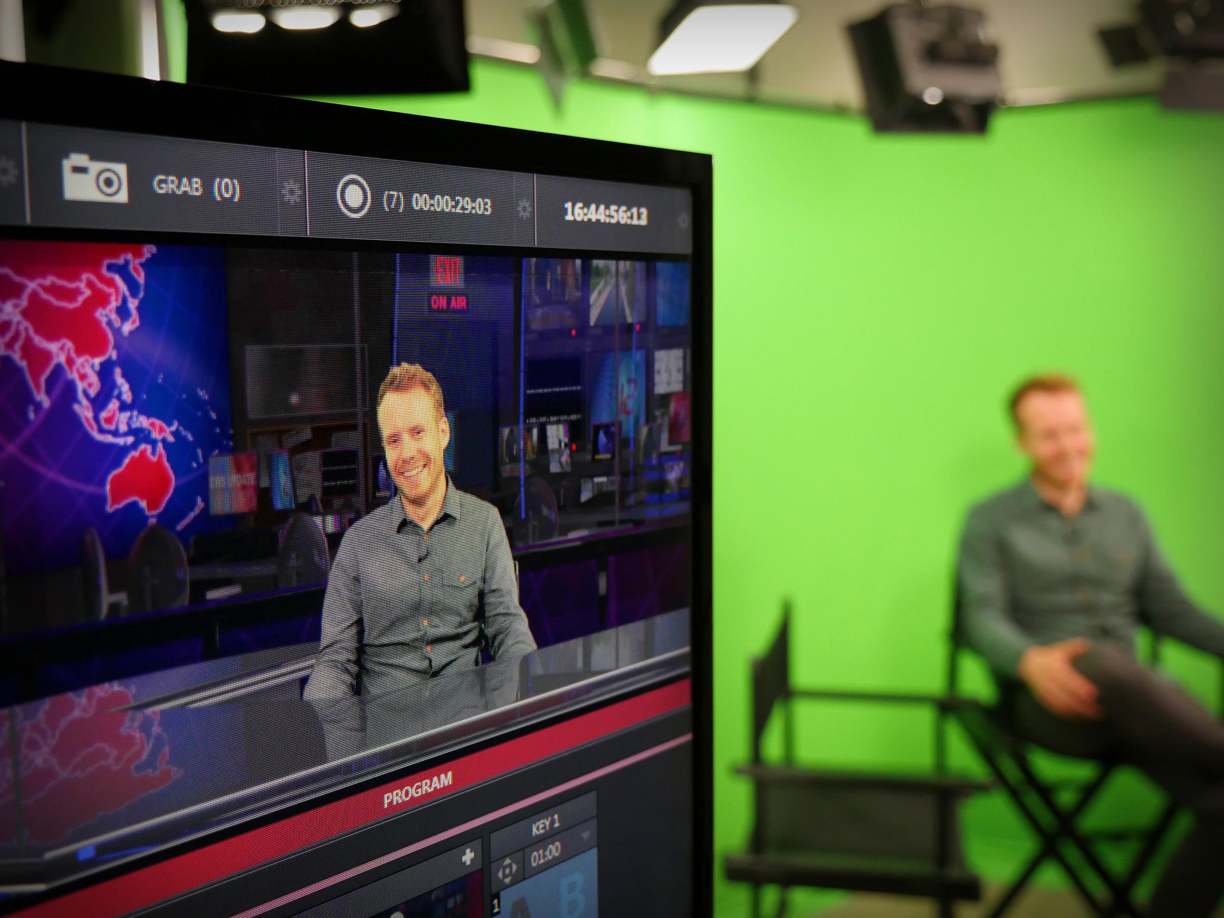 Presenting to camera in our virtual studio set, London, UK